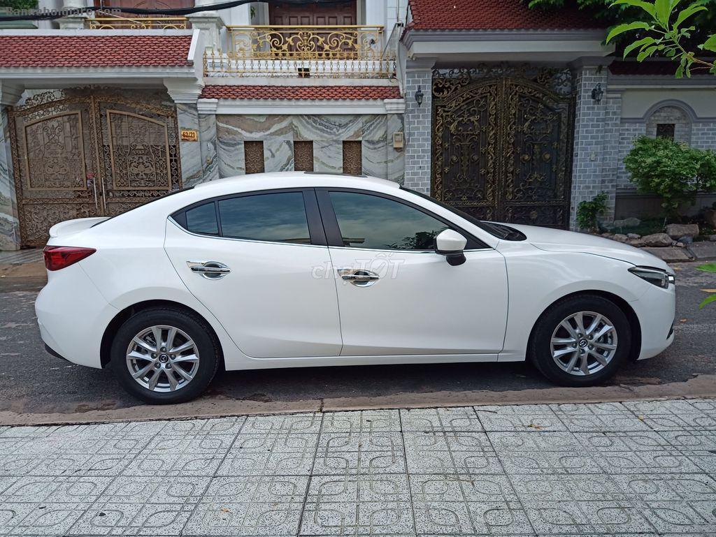 Bán xe Mazda 3 AT 2017 FL màu trắng thắng tay điện tử